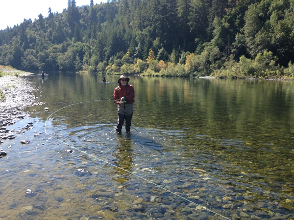 Playing a fish on the Klamath